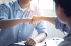 Group of man punch in office, teamwork concept royalty free stock photo