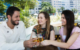Group of man and woman drinking beer in a bar Stock Photos