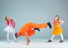 Group of man, woman and teens dancing hip hop choreography Royalty Free Stock Photos