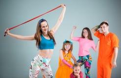 Group of man, woman and teens dancing hip hop choreography Stock Photography