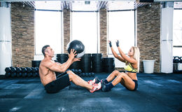 Group of a man and woman workout with fitball Royalty Free Stock Photography