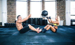 Group of a man and woman workout with fitball Royalty Free Stock Images
