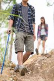 Group of man and women are walking trough forest path wearing m stock photo