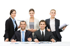 Group of managers debating while sitting at the table Royalty Free Stock Photo