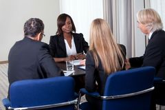 Group of managers interviewing female candidate Stock Photos