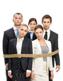 Group of managers tied with rope Stock Photography