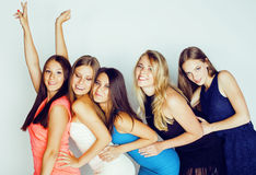 Group of many cool modern girls in bright clothers together having fun isolated on white background, happy smiling Stock Images