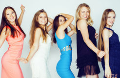 Group of many cool modern girls in bright clothers together having fun isolated on white background, happy smiling Stock Photography
