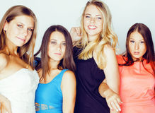 Group of many cool modern girls friends in bright clothers together having fun isolated on white background, happy Royalty Free Stock Photos