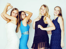 Group of many cool modern girls friends in bright clothers together having fun isolated on white background, happy Royalty Free Stock Photo