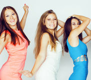 Group of many cool modern girls friends in bright clothers together having fun  on white background, happy Royalty Free Stock Photos