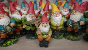 Many little garden gnomes. Group of many little garden gnomes stock photos