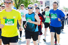 A group of marathon runners compete at the Spring Half Marathon Royalty Free Stock Photos