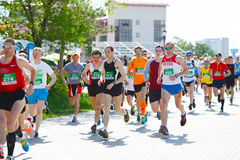 A group of marathon runners compete at the Spring Half Marathon Royalty Free Stock Photography