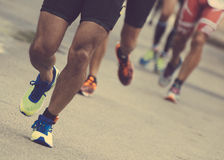 Group of marathon runners. Group of marathon runners on the street Royalty Free Stock Image