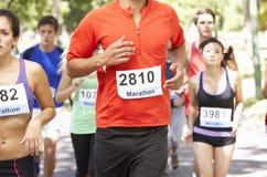 Group Of Marathon Runners At Start Of Race Stock Photos