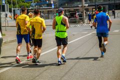 Group of marathon runners on the street in Ukraine. royalty free stock photos