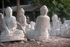 Group of Marble Buddha was carved Placed outside. Royalty Free Stock Images