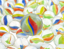 Group of marbles with one big one Stock Image