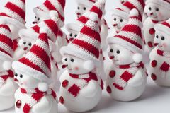 Group of marching little snowmen Royalty Free Stock Photography
