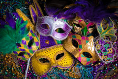 Group of Mardi Gras Mask on dark background with beads Royalty Free Stock Image