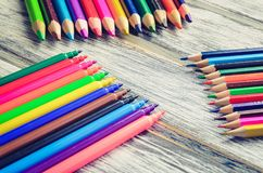 Colorful school supplies. Group of markers and crayons on a wooden table stock photography