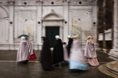 Group of masked friends in the Carnival of Venice stock photography