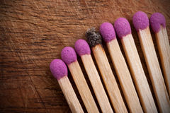 Group of matchsticks and a used one. Royalty Free Stock Image