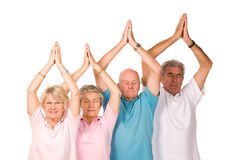 Group of mature people doing yoga. Group of older mature people doing yoga exercises, isolated on white background stock photo
