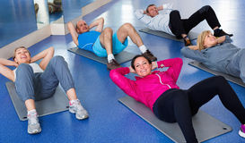 Group of mature people exercising on sport mats Royalty Free Stock Photography