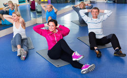 Group of mature people exercising on sport mats Royalty Free Stock Images