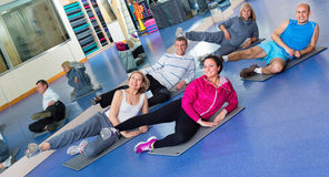 Group of mature people exercising on sport mats Stock Image
