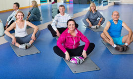 Group of mature people exercising on sport mats Royalty Free Stock Photos