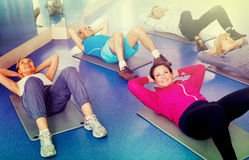 Group of mature people exercising on sport mats Stock Photos