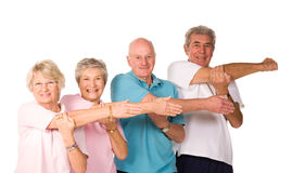 Group of mature people stretching stock photography