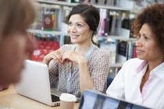 Group Of Mature Students Collaborating On Project In Library Royalty Free Stock Photography