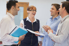Group of mature students standing in classroom chatting Stock Photos