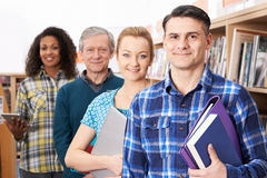 Group Of Mature Students Studying In Library. Mature Students Studying In Library Royalty Free Stock Image