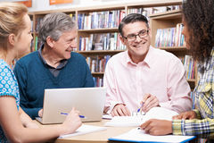 Group Of Mature Students Studying In Library stock photography