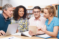 Group Of Mature Students Studying In Library. Group Of Mature Students In Library Royalty Free Stock Photo