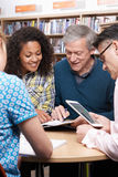 Group Of Mature Students Studying In Library. Together Royalty Free Stock Images
