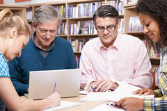 Group Of Mature Students Studying In Library Royalty Free Stock Image