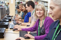 Group Of Mature Students Working At Computers Stock Image