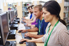 Group Of Mature Students Working At Computers stock photo
