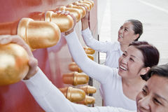 Group of mature women standing next to the traditional Chinese door Royalty Free Stock Photography