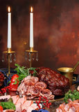 Group of meat on holiday table with candles Stock Photo