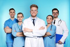 Group of medical doctors on color background royalty free stock photo