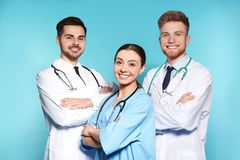 Group of medical doctors on color background stock photos