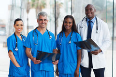Group medical doctors. Group of medical doctors in office with patient's x-ray royalty free stock photography