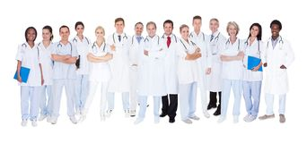 Group of medical doctors. Group Of Smiling Doctors With Stethoscopes Over White Background stock photo